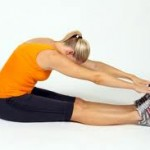 Hamstring stretches seated on the floor while bending over to touch toes.